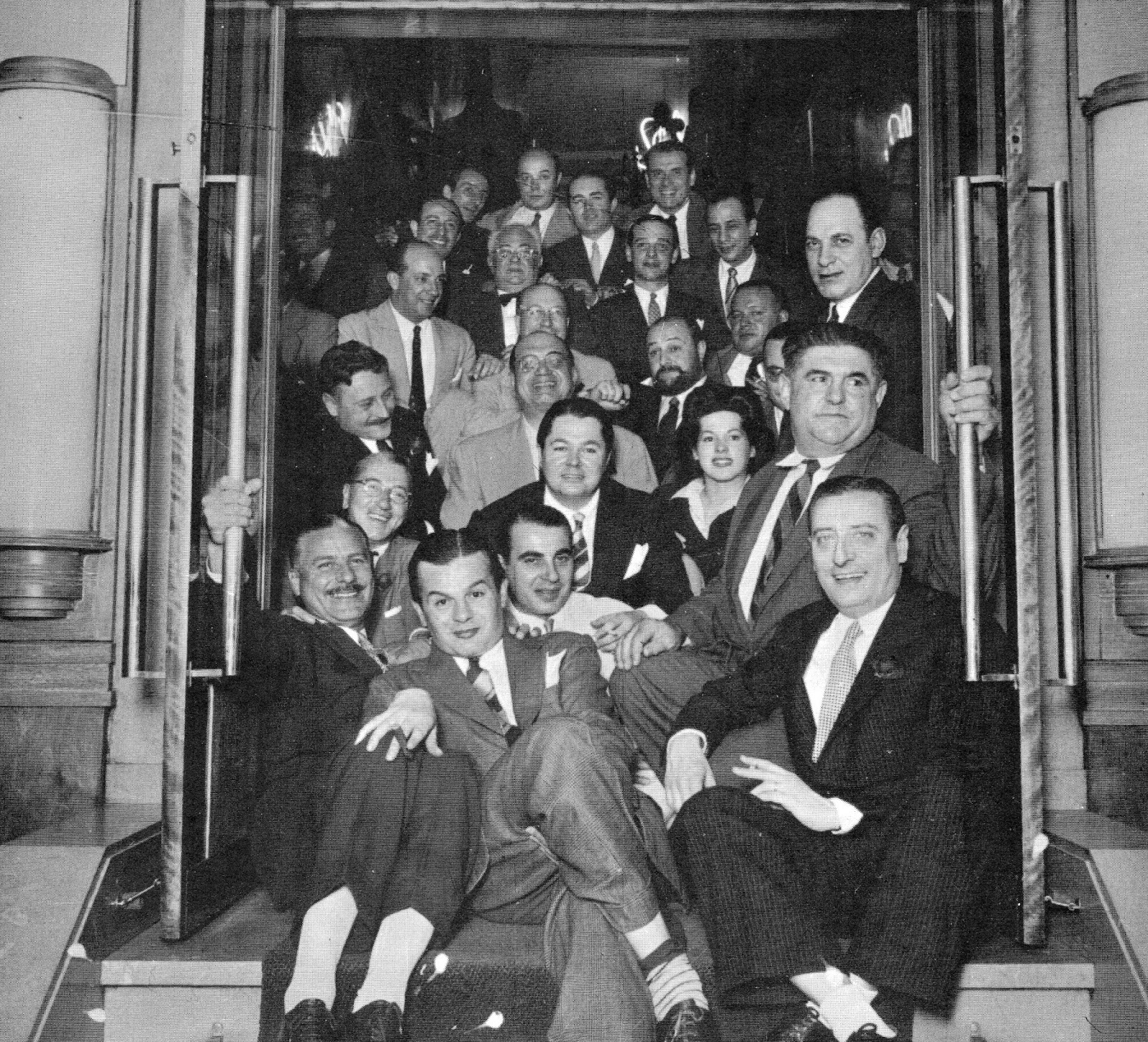 Troilo in the centre, surrounded by friends and other tango artists