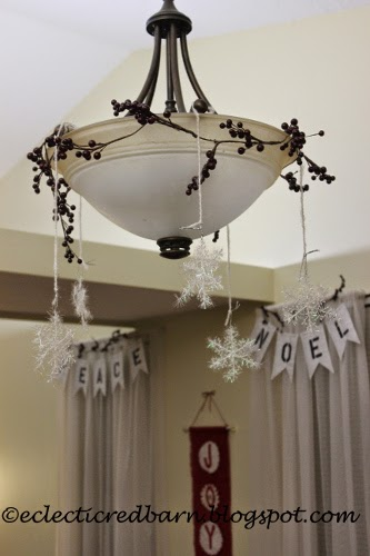 Eclectic Red Barn: Dining room light with berries and snowflakes