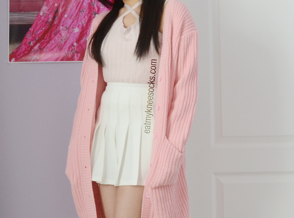 JollyChic's oversized longline pink cardigan is the same as that of Stylenanda, a popular South Korean fashion brand.
