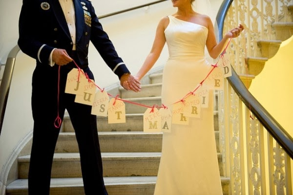 http://www.weddingbells.ca/planning/wedding-decor/creative-bunting-ideas-for-your-wedding/attachment/creative-bunting-ideas-just-married/