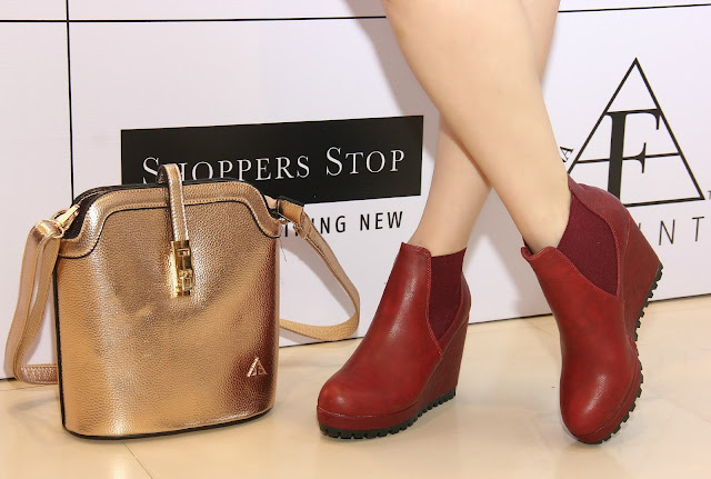 Femina FLAUNT Launch '15 at Shoppers Stop, burgundy wedge ankle boots,rose gold metallic handbag