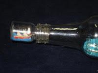 tampa-miniatura-de veleiro-na-garrafa