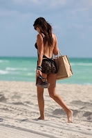 Claudia Romani going home after a day at the beach