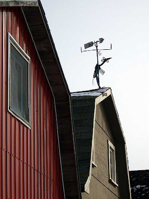 This weathervane looks like it was homemade from old garden tools.