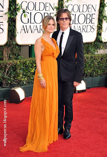 Actors Kyra Sedgwick and Kevin Bacon arrive at the 68th Annual Golden Globe Awards
