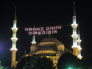 The Blue Mosque at night.  The lights translate to Pillar of Religion in Prayer.