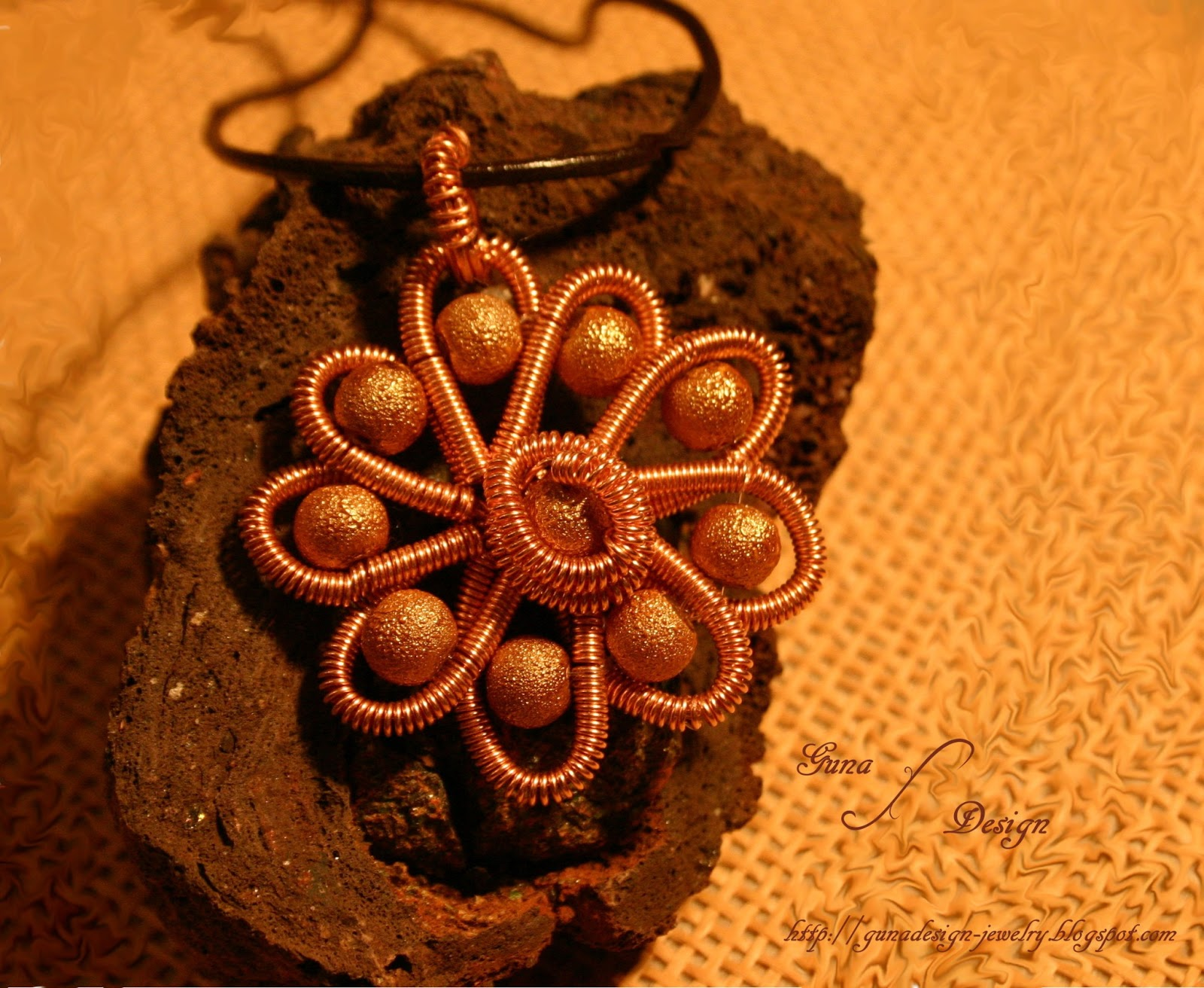 handmade coiled wire flower pendant with beads made by gunadesign