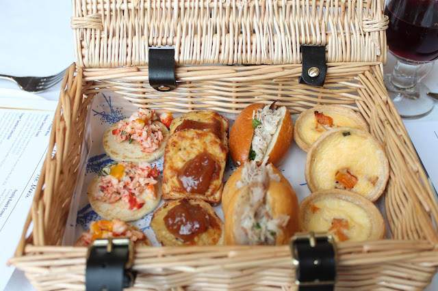 picnic basket of pastries at celtic manor afternoon tea