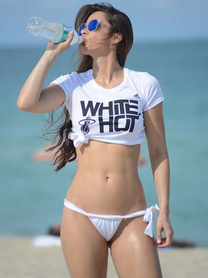 "The 28-year-old wore a tiny white bikini and teamed her enviable curvy frame in a white shirt by inscription: ""White Hot."""