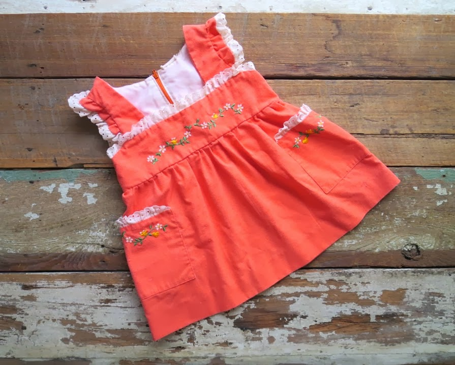 https://www.etsy.com/listing/182303552/vintage-embroidered-orange-folk