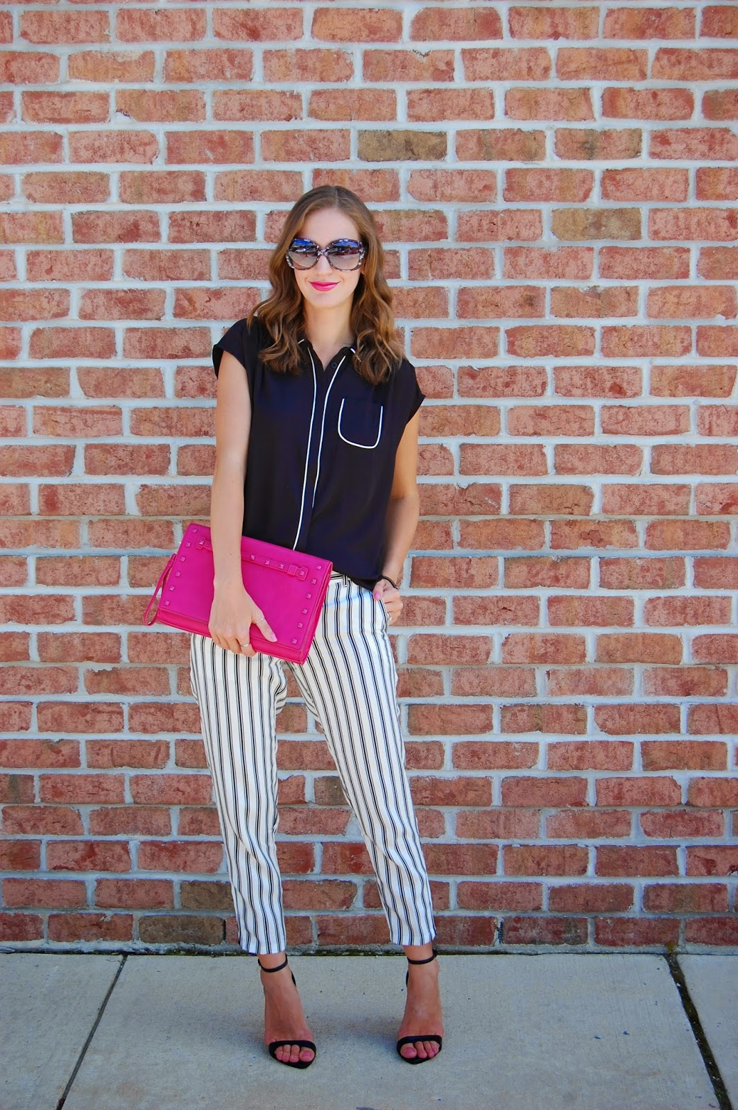 Wearing Loft new summer arrivals, Black Piped shirt, Striped Summer Pants in Marisa Fit, Neiman Marcus Last Call Pink Tonal Stud Trim Clutch, Zara Black Ankle Strap Heels, Black and White Outfit