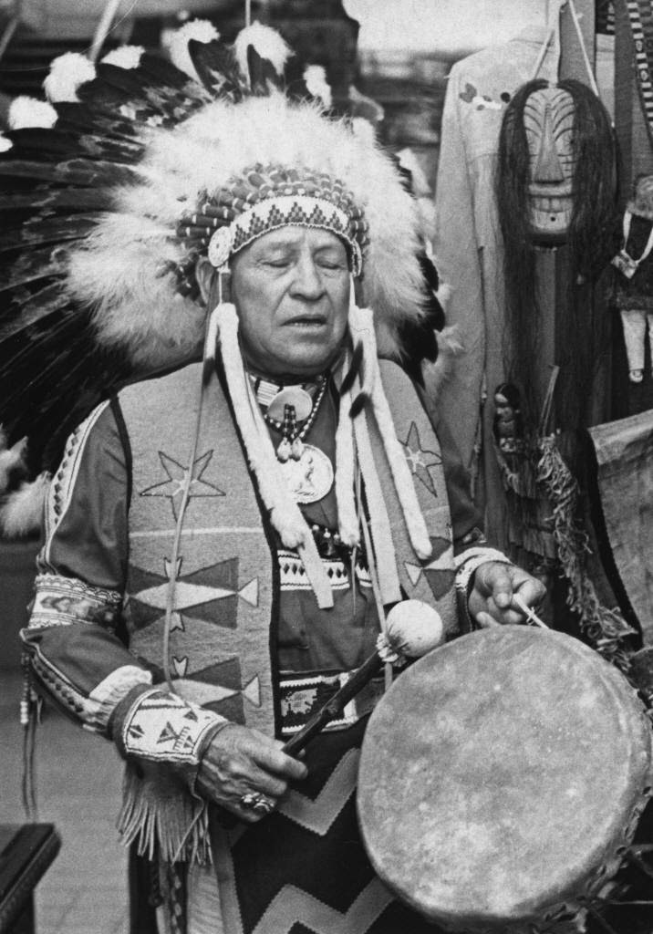 Native American Indian with Headdress and Drum