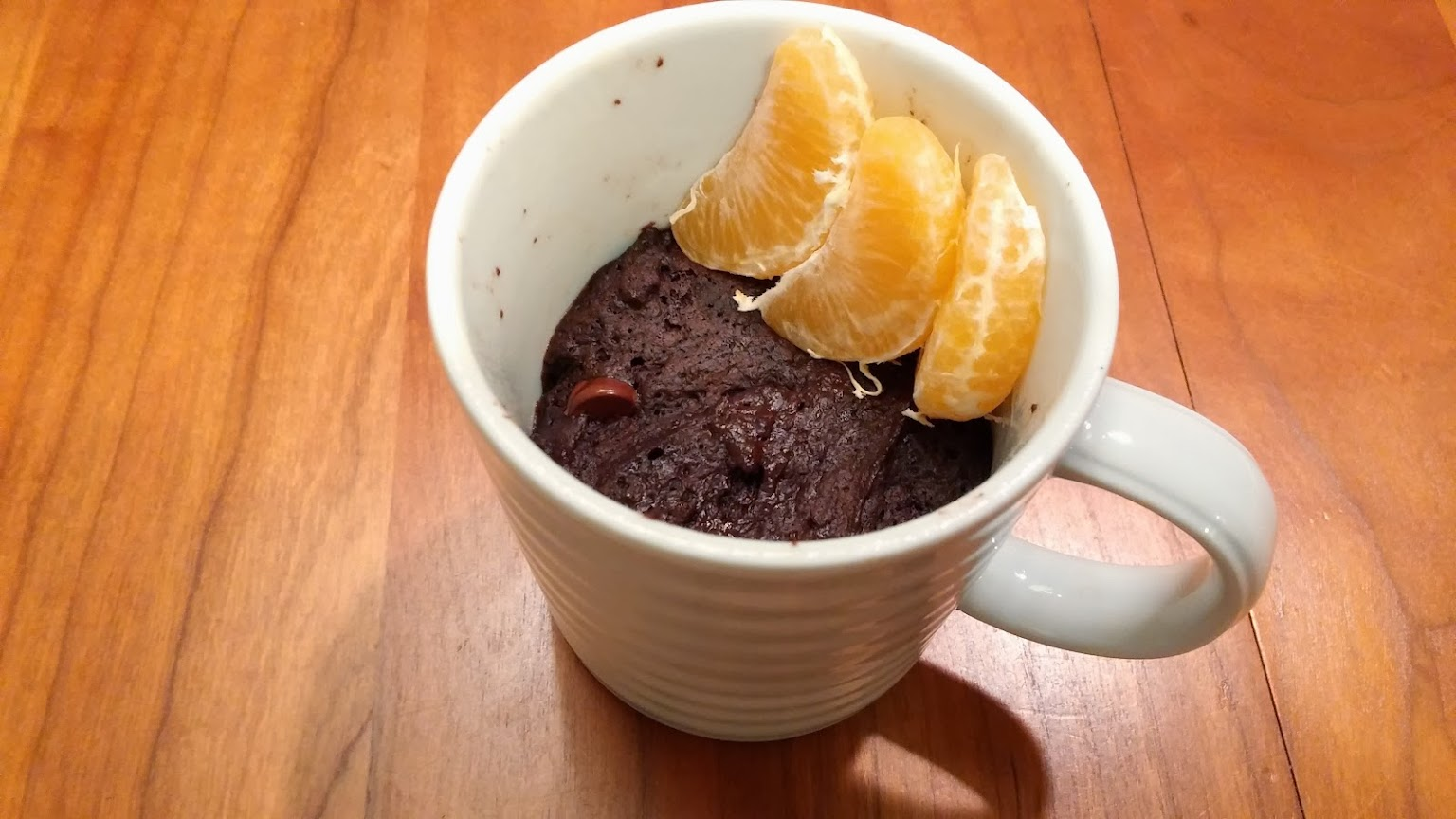 Chocolate mug cake with clementine orange pieces