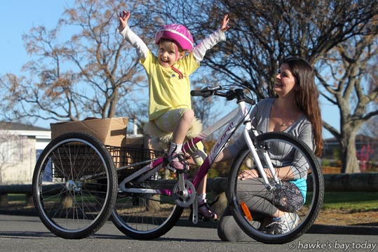 Kayla Smith, 5, with her mother Julie Smith, Napier - story about Kayla who has Spina Bifida, and has just got a new custom trike that will help strengthen muscle and help her get around. photograph