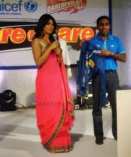 Bollywood beauty Priyanka chopra pink saree stills at UNICEF charity ...