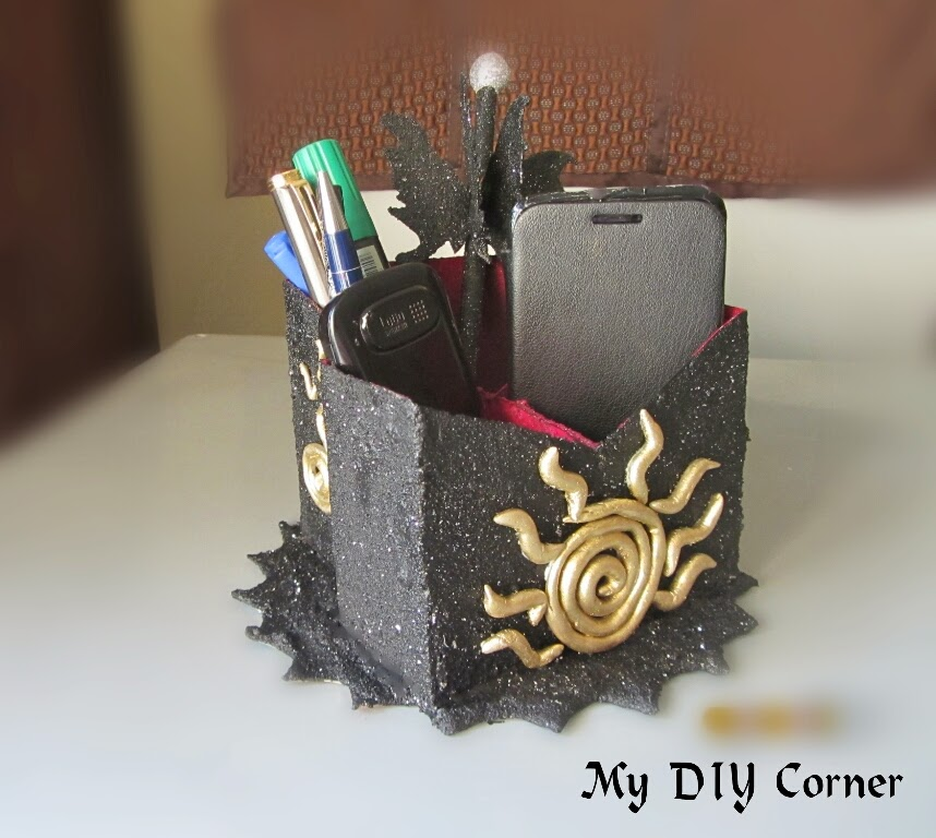 http://www.mydiycorner.in/upcycled-phone-stand/