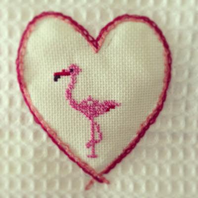 flamingo with cross stitch