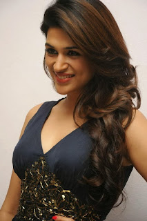 Actress Shraddha Das Pictures in Long Dress at Rey Movie Trailer Launch  0012