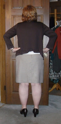 Here's the back cut-out ruffle thing. I kind of like my top peeking ...