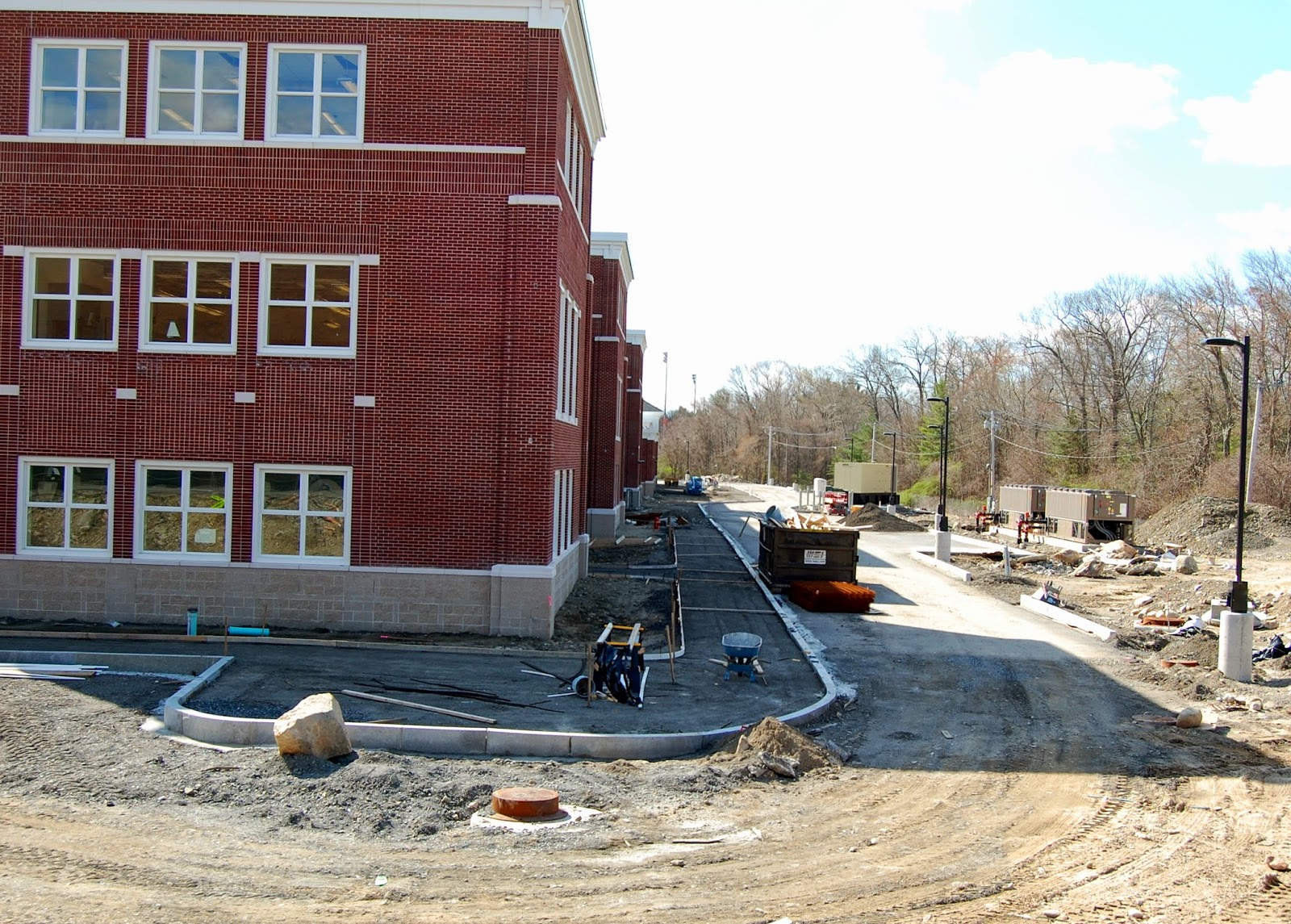 new FHS - sidewalks and landscaping in rear