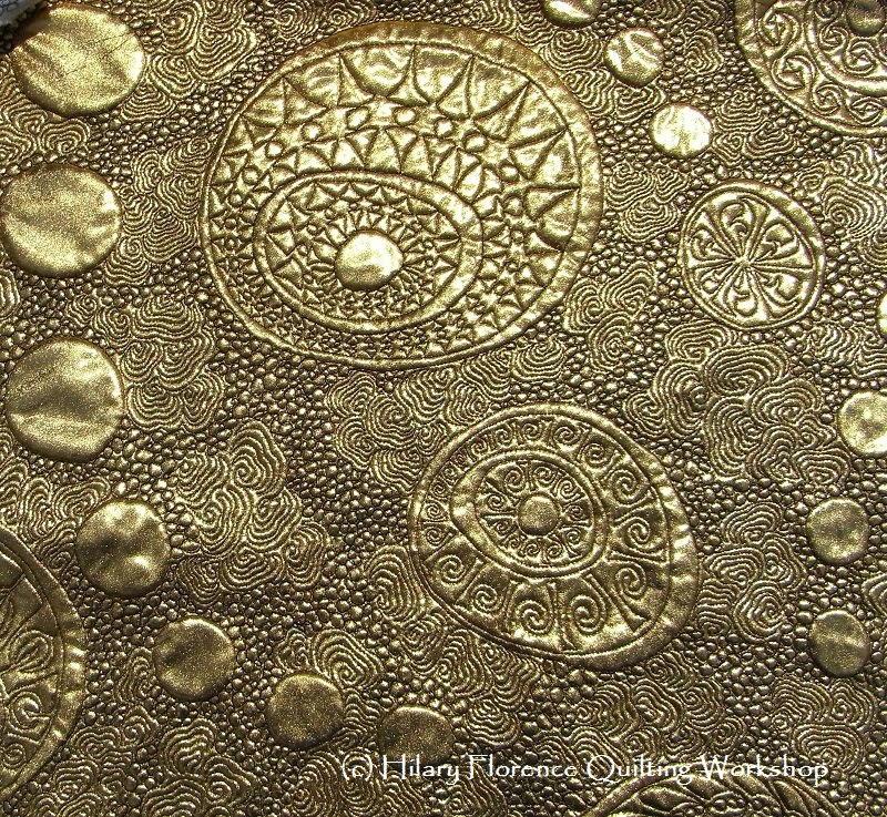 Free motion quilting on gold metallic foil fabric show quilt for festival of quilts