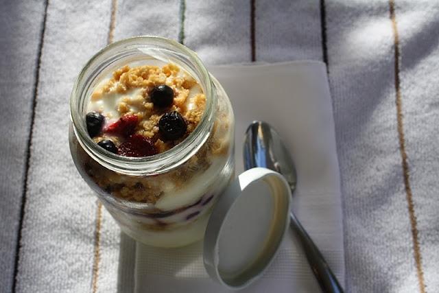Top down shot of graham cracker triple berry yogurt parfait.