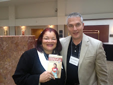 "Dr. Alveda King receives a copy of Chloe's Book ""Making a Case for Life"" at an International Forum"