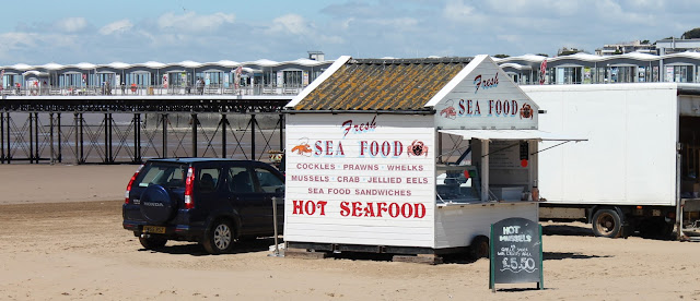 sea food stand on Weston Super Mare beach with Grand Pier in background