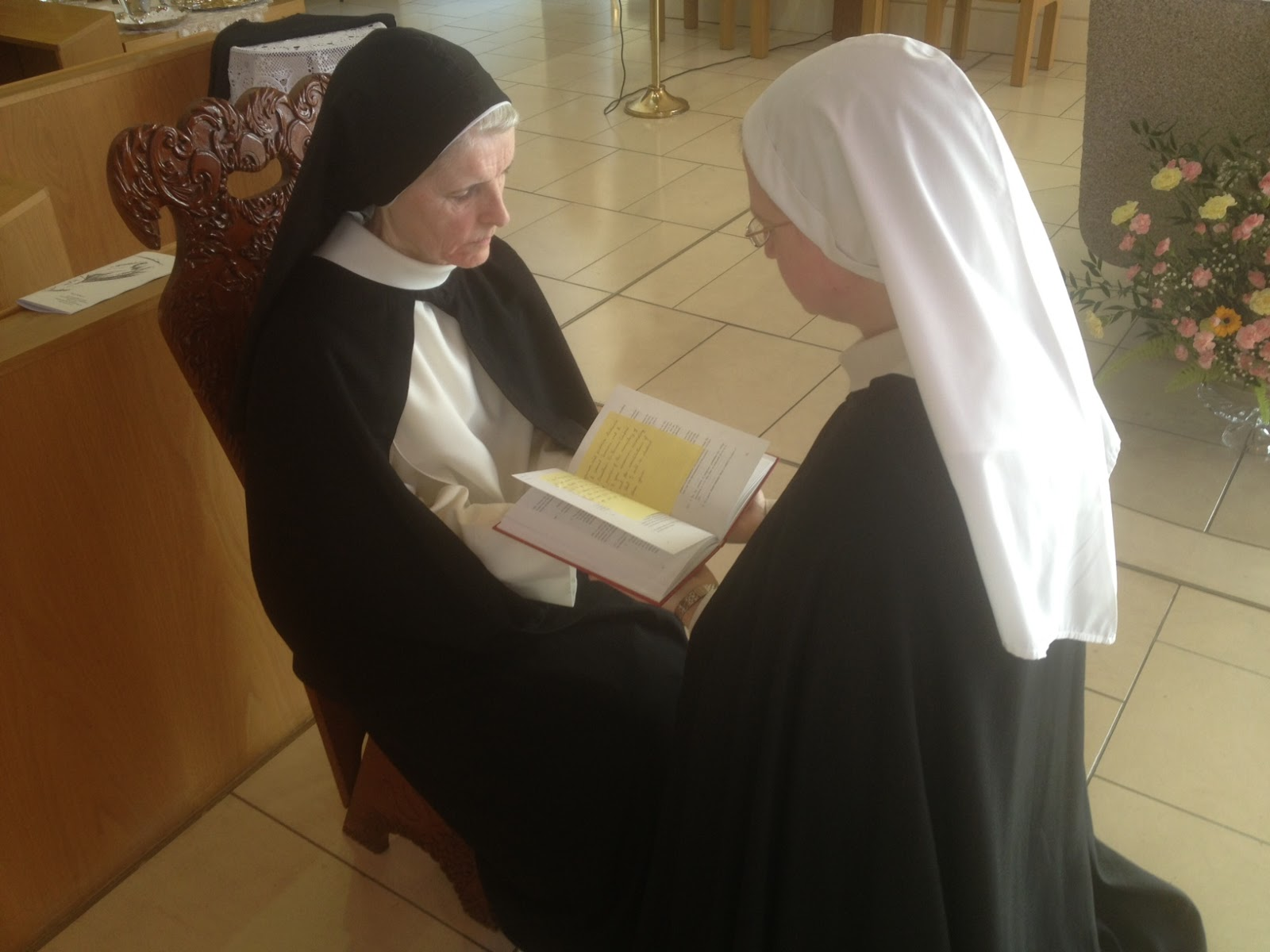 Sr mary cathy makes profession in the hands of the prioress sr mary