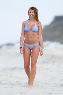 Amy Willerton walking down the beach