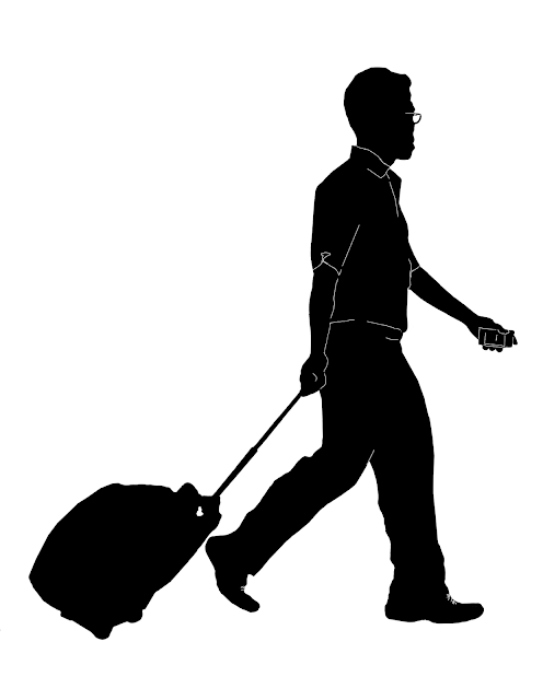 silhouette of an Asian man with a trolley bag