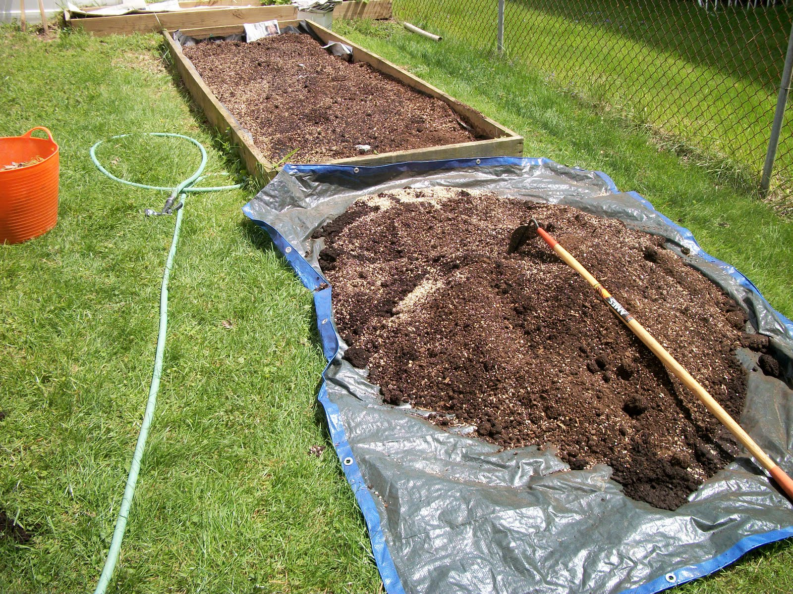 The Book Recommends Mixing The Soil On A Tarp. I Used A Hoe To Mix Together  And When I Was Finished, My Husband Helped Me Dump Each Load Into The Garden .