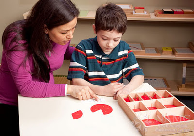 NAMC teacher presenting montessori lessons show don't tell fractions boy