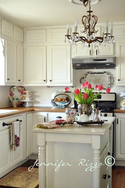 White kitchen with vintage chandelier