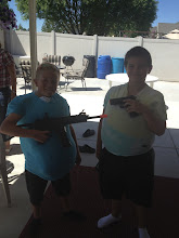 Braken and cousin Blake playing with the air guns