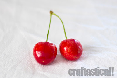two beautiful cherries, Royal Ann or corum cherries, reminds me of the Pac man video game cherries when they are connected like this
