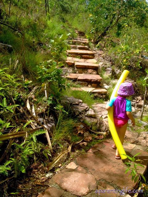 Little girl walking on a stone path