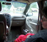 You may notice the teepee through the windshield of the photo, Patti already in her water proof wheelchair lap blanket, a reflection of me taking the picture in the rear view mirror and the sheer boredom captured on Patti's face.