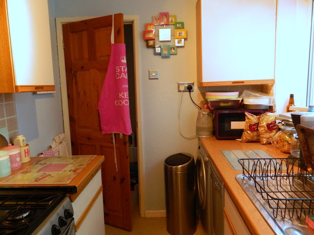 before photo of kitchen makeover pale blue walls dark and small kitchen