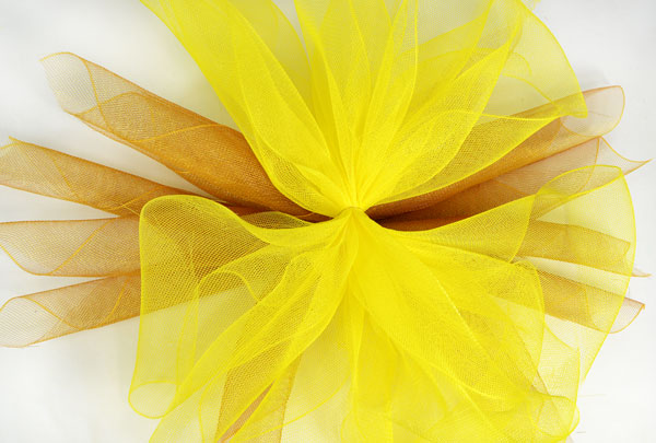 Sumflower tutorial- Layer the two colors of deco mesh petals on top of one another.