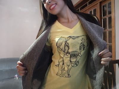 Look passeio: estampa de elefante e colete