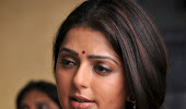 Bhoomika latest spicy photo gallery in red saree