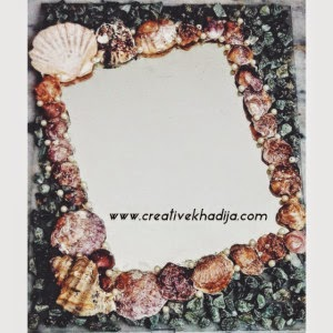 http://creativekhadija.com/2014/04/mirror-decoration-shells-stones/