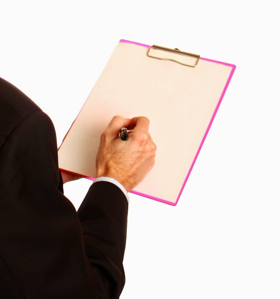 title: young businessman holding a clipboard and pen; take by: Benjamin Miller; source: http://www.freestockphotos.biz/