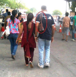 Ladies Handbag is on the shoulder of a Man - India