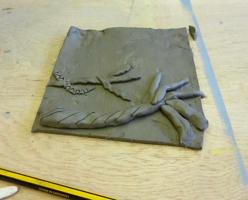 Paper hat parties clay relief sculptures