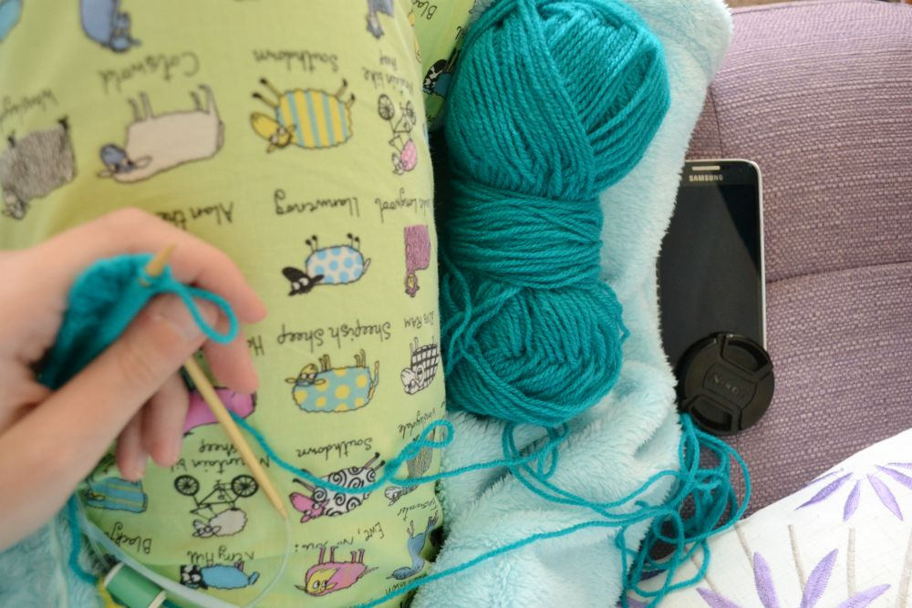 pyjamas knitting phone couch