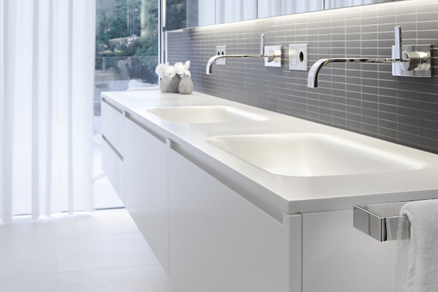 Modern white double sink in the bathroom