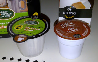 Shows a Vue Pack next to a K-cup for size comparision