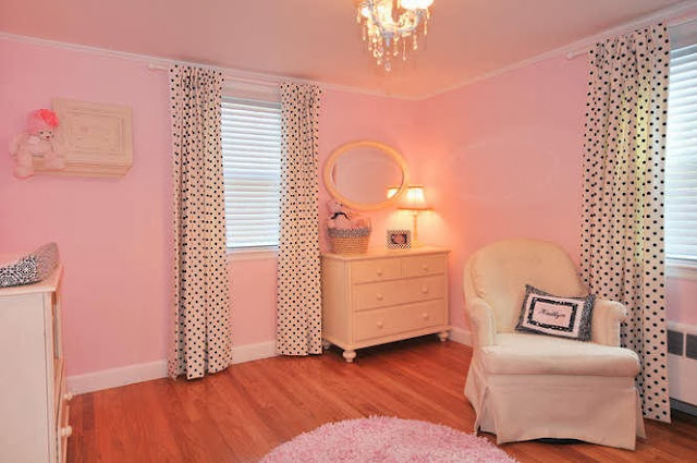 lovely pink wall painting surrounding creamy color furniture and fun polkadot pattern curtains